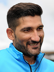 Somerset's Sohail Tanvir smiles after being interviewed prior to the start of play. Photo mandatory by-line: Harry Trump/JMP - Mobile: 07966 386802 - 25/05/15 - SPORT - CRICKET - LVCC County Championship - Division 1 - Day 2- Somerset v Sussex Sharks - The County Ground, Taunton, England.