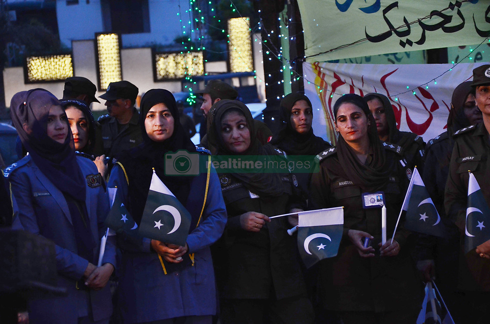 August 4, 2017 - Lahore, Punjab, Pakistan - Pakistani Inspector General of Police Punjab Captain (Retired) Arif Nawaz Khan along with other police officials and civil society workers lit the candles at Yadgar-e-Shuhada ahead of a martyrdom  day of police to pay homage to martyrs of Police laying their lives for defense of motherland in Lahore. The martyrdom day of police remembrance on 04 August annually. (Credit Image: © Rana Sajid Hussain/Pacific Press via ZUMA Wire)