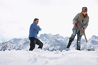Couple playing in snow on hill low angle view