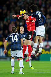 Cardiff Midfielder Jordon Mutch (ENG) and Man Utd Midfielder Marouane Fellaini (BEL) compete in the air during the first half of the match - Photo mandatory by-line: Rogan Thomson/JMP - Tel: Mobile: 07966 386802 - 24/11/2013 - SPORT - FOOTBALL - Cardiff City Stadium - Cardiff City v Manchester United - Barclays Premier League.