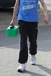 © Licensed to London News Pictures. 30/03/2012.Petrol Panic buying today 30.03.2012..Man filling a Jerry can at the BP garage on the A21 Lamberhurst Quarter, Kent..****WARNING   READ MANS T-SHIRT***.Photo credit : Grant Falvey/LNP