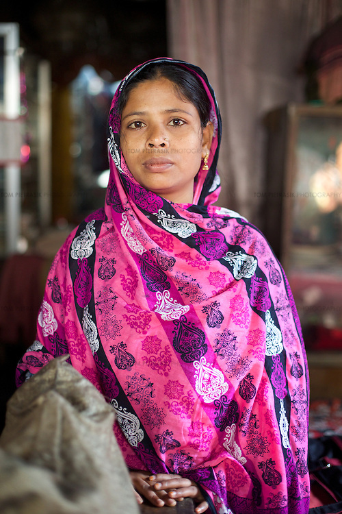 Jahanara Akhtar, age 27, at a neighbours home in 36 Bari Colony in Mymensingh.<br /> <br /> Photo: Tom Pietrasik<br /> Mymensingh, Bangladesh<br /> November 19th 2014