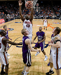 Virginia guard/forward Will Harris (43) follows through a basket against Northwestern.  The Virginia Cavaliers men's basketball team defeated the Northwestern Wildcats 94-52 at John Paul Jones Arena in Charlottesville, VA on November 27, 2007.