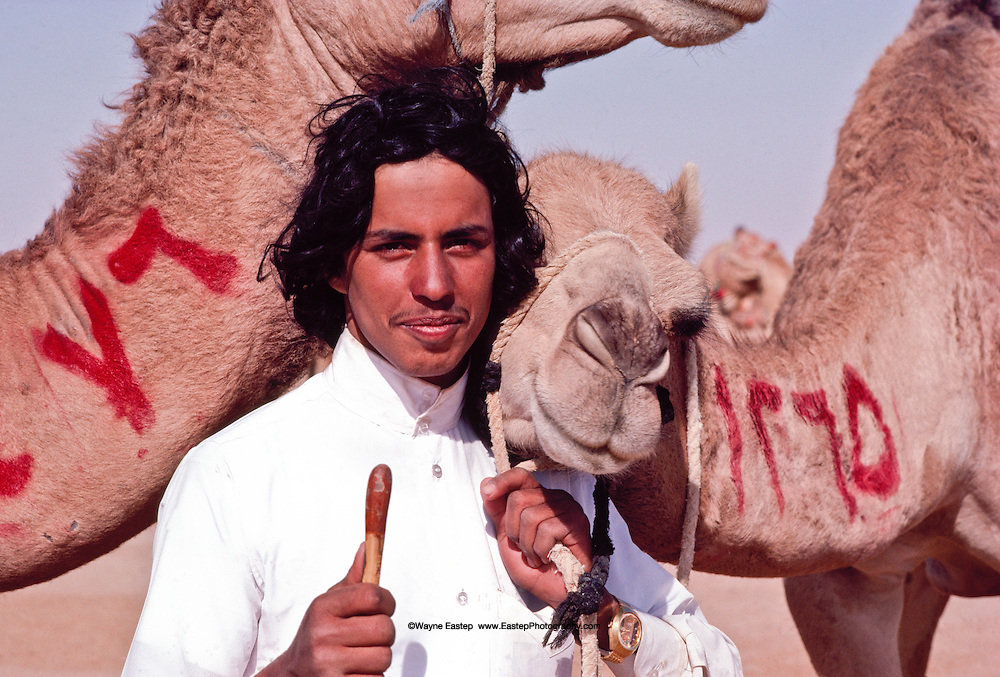 Competitor with his camel at the annual camel race at Jinayderiah, near Riyadh, Saudi Arabia