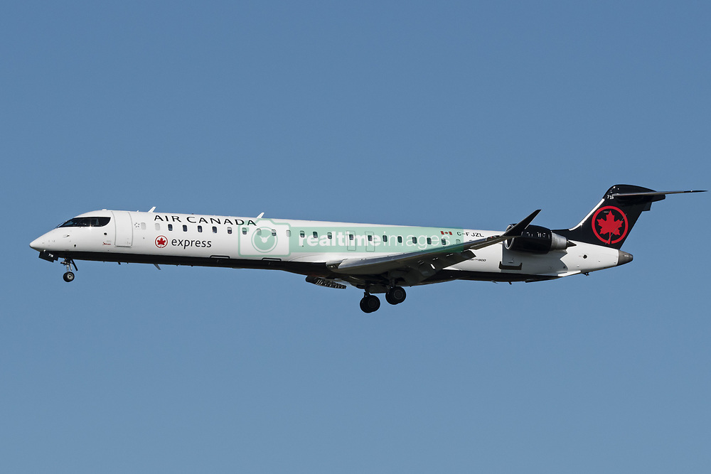 October 2, 2017 - Richmond, British Columbia, Canada - An Air Canada Express Bombardier CRJ-900 (C-FJZL) single-aisle narrow-body regional jet airliner, painted in the airline's new look livery, airborne on final approach for landing. The aircraft is owned and operated by Jazz Aviation under contract to Air Canada. (Credit Image: © Bayne Stanley via ZUMA Wire)