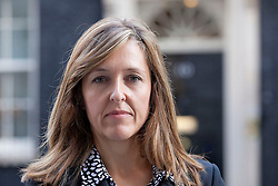 © Licensed to London News Pictures. 16/09/2013. London, UK. Paula Barrow, a 45 year old mother of two from Manchester, is seen on Downing Street in London today (16/09/2013) after delivering a petition calling for a 'Daniel's Law. The petition, which is still open and gathering signatures, asks for a law calling for the mandatory reporting of suspected child abuse by those working with children and is named in the memory of Daniel Pelka, a four year old who starved and beaten for months before he died. Photo credit: Matt Cetti-Roberts/LNP