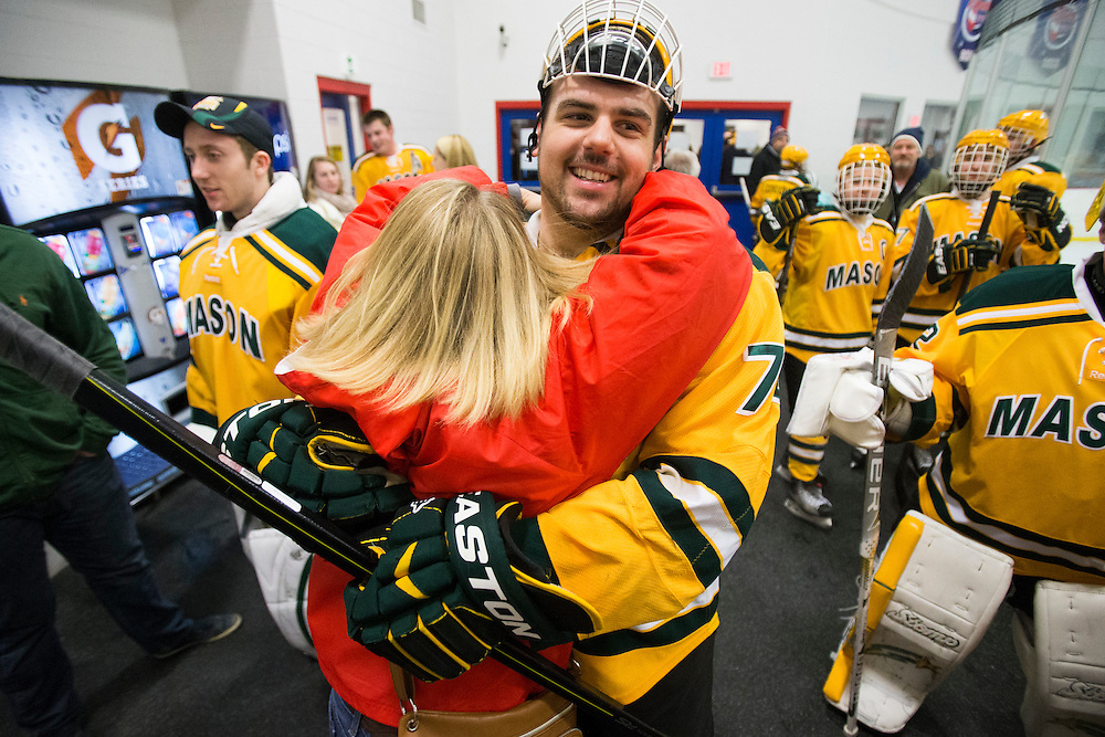 George Mason forward, Justin Satkowski, hugs Csilla Aglaure-Szekelyhidi during intermission on senior night against Northern Virginia Community College at Prince William Ice Rink in Woodbridge, VA on January 31, 2014.
