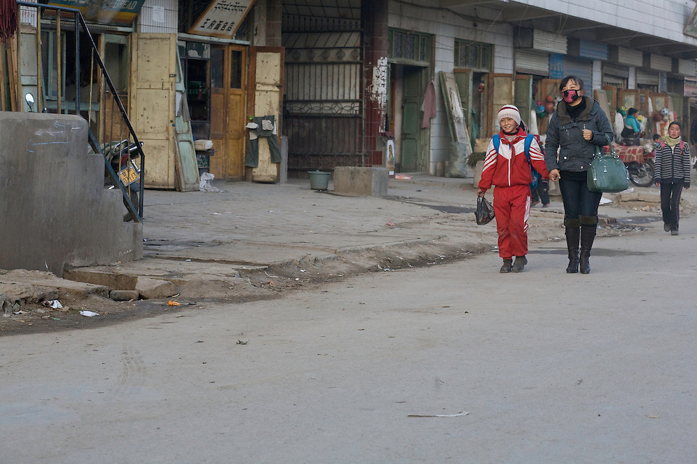 "Children going back to home after the school in the tibetan part of Xiahe. They wear the red scarf of ""pionners""."