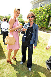 YASMIN LE BON and JAY KAY at a luncheon hosted by Cartier for their sponsorship of the Style et Luxe part of the Goodwood Festival of Speed at Goodwood House, West Sussex on 5th July 2009.