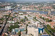 Nederland, Zuid-Holland, Dordrecht, 08-09-2006;  ; stadsgezicht met spoorbrug over de Oude Maas en rechts de Grote Kerk, op de tegenover gelegen oever van de rivier Zwijndrecht; binnenstad, stedelijkijheid verstedelijking, kerktoren, skyline; luchtfoto (toeslag); aerial photo (additional fee required); .foto Siebe Swart / photo Siebe Swart