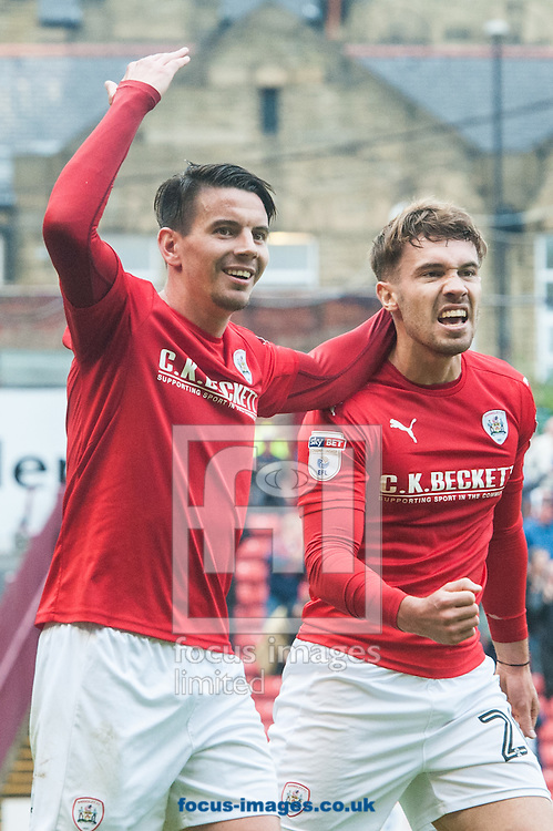 Tom Bradshaw (right) celebrates with Adam Hammill of Barnsley after scoring his sides third goal during the Sky Bet Championship match at Oakwell, Barnsley<br /> Picture by Matt Wilkinson/Focus Images Ltd 07814 960751<br /> 27/08/2016