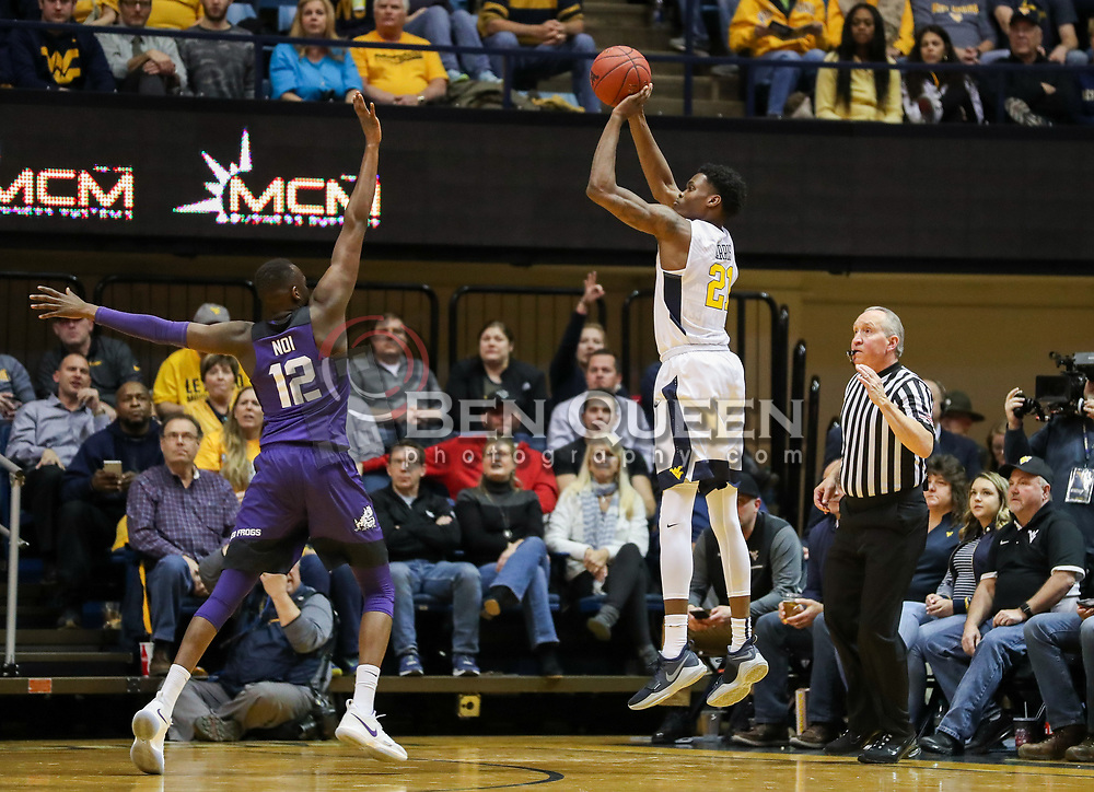 Feb 12, 2018; Morgantown, WV, USA; West Virginia Mountaineers forward Wesley Harris (21) shoots a three pointer during the first half against the TCU Horned Frogs at WVU Coliseum. Mandatory Credit: Ben Queen-USA TODAY Sports