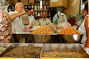 Israel, Tel Aviv, Lewinski market, buyers and sellers at a spice stall