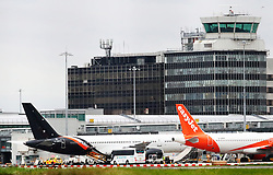 A general view of the Manchester City team and arriving at Manchester Airport as they travel for their Champions League fixture.