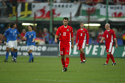 MILAN, ITALY - Saturday, September 6, 2003: Wales' Ryan Giggs dejected after Italy fourth goal during the Euro 2004 qualifying match at the San Siro Stadium. (Pic by David Rawcliffe/Propaganda)