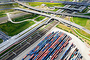 Nederland, Zuid-Holland, Rotterdam, 10-06-2015; <br />  Knooppunt Benelux (A4 / A15). Overslag van containers op terrein ECT Prins Willem-Alexanderhaven, Vondelingeweg.<br /> Infrastructure of motorways and metro (subway), container terminal in Rotterdam harbour area.<br /> <br /> luchtfoto (toeslag op standard tarieven);<br /> aerial photo (additional fee required);<br /> copyright foto/photo Siebe Swart