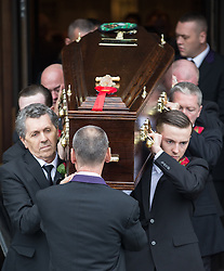© Licensed to London News Pictures . 20/09/2014 . Manchester , UK . Pallbearers carry the coffin out of the cathedral . Departures at the funeral of Heywood and Middleton MP Jim Dobbin at Salford Cathedral today (Saturday 20th September 2014) . Photo credit : Joel Goodman/LNP
