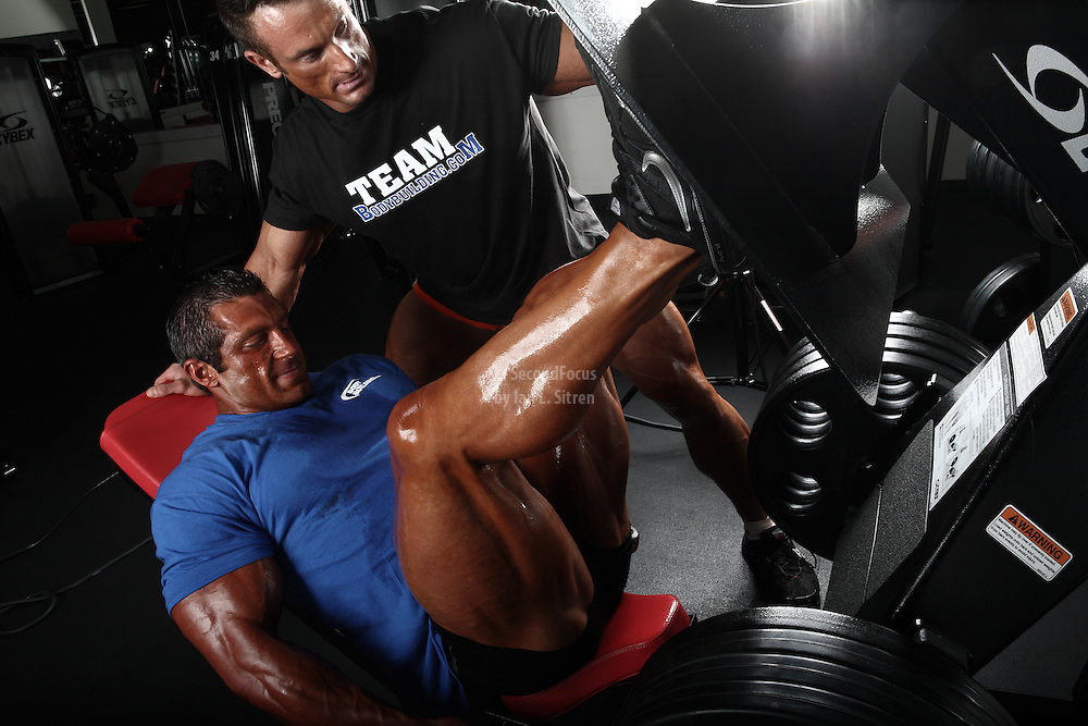 Bodybuilders Dan Decker and Brian Yersky doing leg presses.