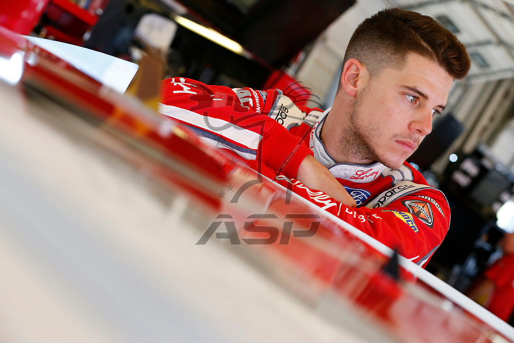 Ryan Reed (16) hangs out in the garage during practice for the Alsco 300 at Kentucky Speedway in Sparta, Kentucky.