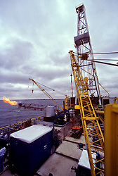 Stock photo of a jackup drilling rig flaring