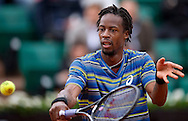 Gael Monfils of France competes in men's singles while Day Sixth during The French Open 2013 at Roland Garros Tennis Club in Paris, France.<br /> <br /> France, Paris, May 31, 2013<br /> <br /> Picture also available in RAW (NEF) or TIFF format on special request.<br /> <br /> For editorial use only. Any commercial or promotional use requires permission.<br /> <br /> Mandatory credit:<br /> Photo by © Adam Nurkiewicz / Mediasport