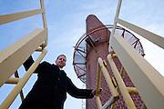 Mike Gebeke, executive director of facilities management stands in front of the smokestack at the Laverne F. Lausche Heating Plant. The smokestack has gone unused since Ohio University began burning gas instead of coal.