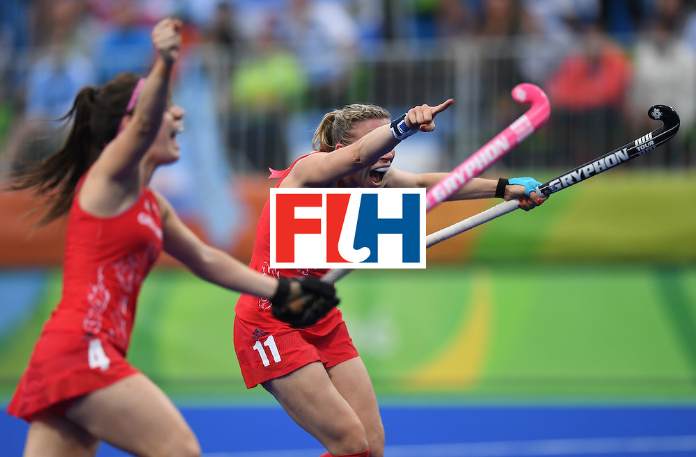 Britain's Kate Richardson-Walsh (R) celebrates scoring a goal during the women's field hockey Britain vs Argentina match of the Rio 2016 Olympics Games at the Olympic Hockey Centre in Rio de Janeiro on August, 10 2016. / AFP / MANAN VATSYAYANA        (Photo credit should read MANAN VATSYAYANA/AFP/Getty Images)