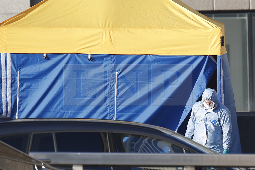 © Licensed to London News Pictures. 30/11/2019. London, UK. A police forensics officer is seen leaving an evidence tent covering the body of the attacker on London Bridge the day after a terrorist attack. Two people were killed and three injured after the attacker, named by police as 28-year-old Usman Khan stabbed a man and a woman to death on London Bridge. Photo credit: Peter Macdiarmid/LNP