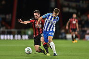 Brighton and Hove Albion midfielder Jayson Molumby (49) and AFC Bournemouth midfielder Lewis Cook (16) during the EFL Cup match between Bournemouth and Brighton and Hove Albion at the Vitality Stadium, Bournemouth, England on 19 September 2017. Photo by Adam Rivers.