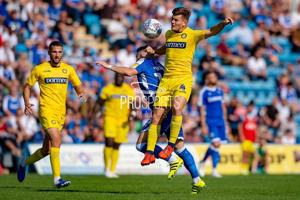 Gillingham FC midfielder Mark Byrne (18) and Wycombe Wanderers midfielder Dominic Gape (4) during the EFL Sky Bet League 1 match between Gillingham and Wycombe Wanderers at the MEMS Priestfield Stadium, Gillingham, England on 14 September 2019.
