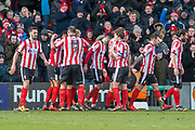 Lincoln City celebrate as Lincoln City Midfielder Lee Frecklington scores a goal 1-0 during the EFL Sky Bet League 2 match between Lincoln City and Grimsby Town FC at Sincil Bank, Lincoln, United Kingdom on 17 March 2018. Picture by Craig Zadoroznyj.