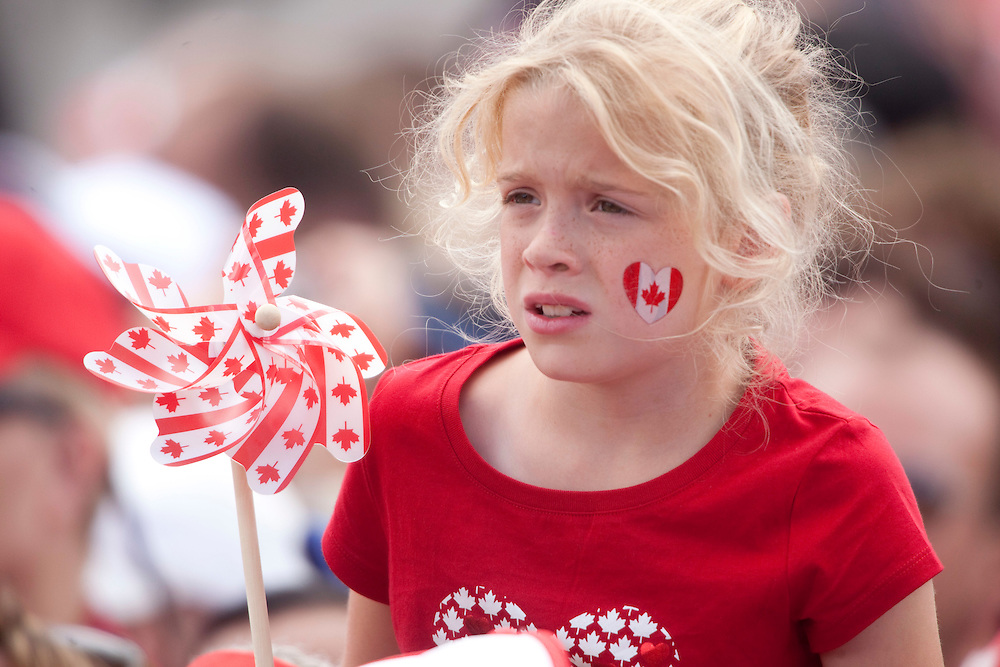 A young girl watches Canada Day celebrations on Parliament Hill in Ottawa, Ontario, July 1, 2010. <br /> AFP/GEOFF ROBINS/STR