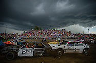 Demolition derby drivers compete through looming storm cells and impending rain on Sunday, July 31, 2016 at the Chataqua Co. Fairgrounds in Durnkirk, New York.