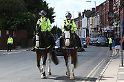 Police presence as fans celebrate outside the stadium and through the city before and during the Premier League match between Liverpool and Aston Villa at Anfield, Liverpool, England on 5 July 2020.