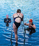Triathletes take part in a swimming session at Long Lake with Paralympic swimmer Stephanie Dixon on Aug. 2, 2016.