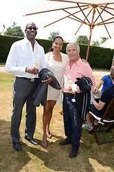 Left to right, EDWIN MOSES, MICHELLE STRANIS and GIACOMO AGOSTINI legendery motorcycle World champion at the Cartier 'Style et Luxe' part of the Goodwood Festival of Speed, Goodwood House, West Sussex on 14th July 2013.
