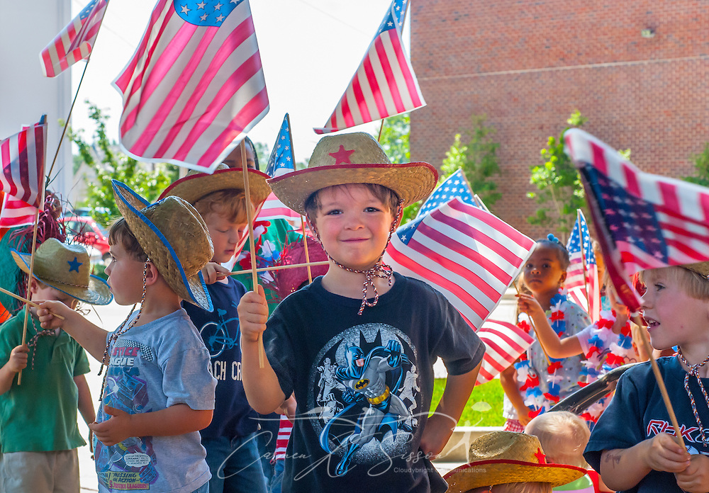 A little boy is surrounded by American flags during a Fourth of July parade, June 30, 2011, in Columbus, Mississippi. (Photo by Carmen K. Sisson/Cloudybright)
