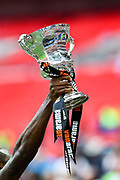 Forest Green Rovers Shamir Mullings(18) lifts up the play off final trophy during the Vanarama National League Play Off Final match between Tranmere Rovers and Forest Green Rovers at Wembley Stadium, London, England on 14 May 2017. Photo by Adam Rivers.