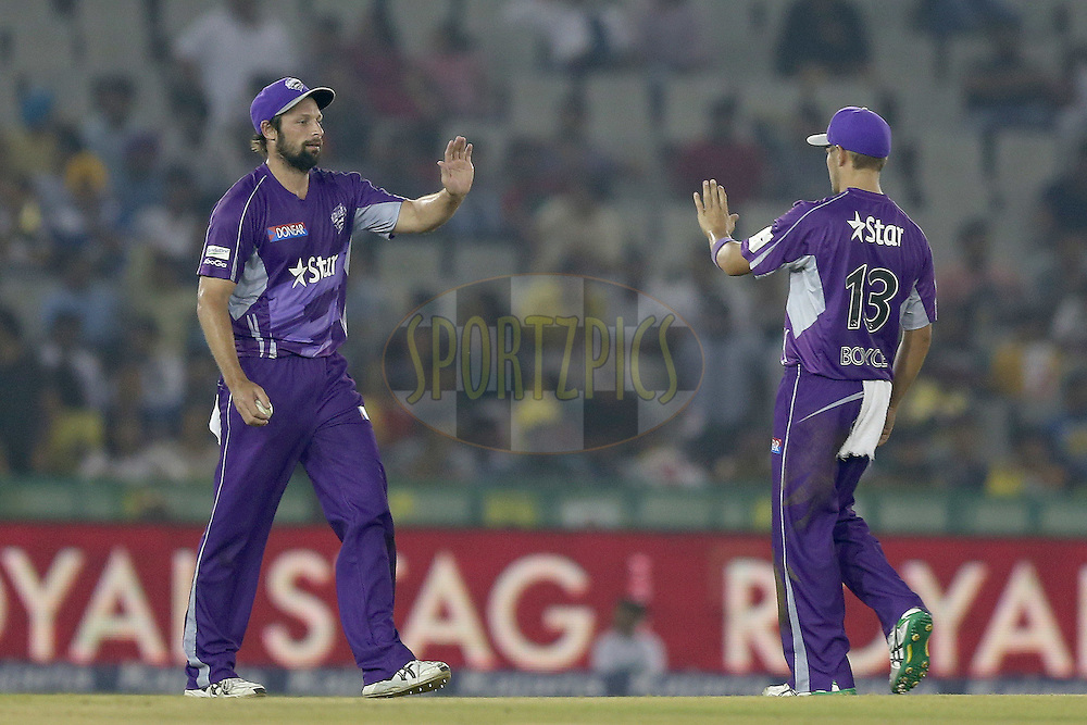 Ben Hilfenhaus is congratulated by his teammates after taking a catch to dismiss Manan Vohra during match 2 of the Oppo Champions League Twenty20 between the Kings XI Punjab and the Hobart Hurricanes held at the Punjab Cricket Association Stadium, Mohali, India on the 18th September 2014. Photo by:  Jacques Rossouw / Sportzpics/ CLT20<br /> <br /> <br /> Image use is subject to the terms and conditions as laid out by the BCCI/ CLT20.  The terms and conditions can be downloaded here:<br /> <br /> http://sportzpics.photoshelter.com/gallery/CLT20-Image-Terms-and-Conditions-2014/G0000IfNJn535VPU/C0000QhhKadWcjYs