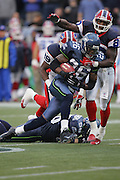 SEATTLE - NOVEMBER 28:  Free safety Ken Hamlin #26 of the Seattle Seahawks avoids a tackle by wide receiver Eric Moulds #80 of the Buffalo Bills after Hamlin pulled down one of his two interceptions for the day at Qwest Field on November 28, 2004 in Seattle, Washington. The Bills defeated the Seahawks 38-9. ©Paul Anthony Spinelli *** Local Caption *** Ken Hamlin;Eric Moulds