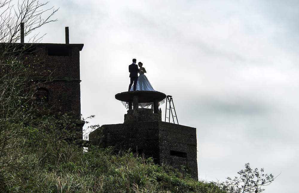Wedding photo shoot on old pillbox on Hai Van Pass.