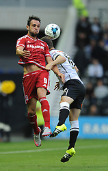 Kike of Middlesbrough challenges for the header with Chris Baird of Derby County - Mandatory byline: Dougie Allward/JMP - 07966386802 - 18/08/2015 - FOOTBALL - iPro Stadium -Derby,England - Derby County v Middlesbrough - Sky Bet Championship