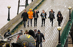 LNP Weekly Highlights 28/03/14  © Licensed to London News Pictures. 24/03/2014; Clevedon, UK. One Direction filming on Clevedon Pier. It is believed the band - Harry Styles, Zayn Malik, Liam Payne, Niall Horan and Louis Tomlinson - were filming for a new music video. Photo credit: Simon Chapman/LNP