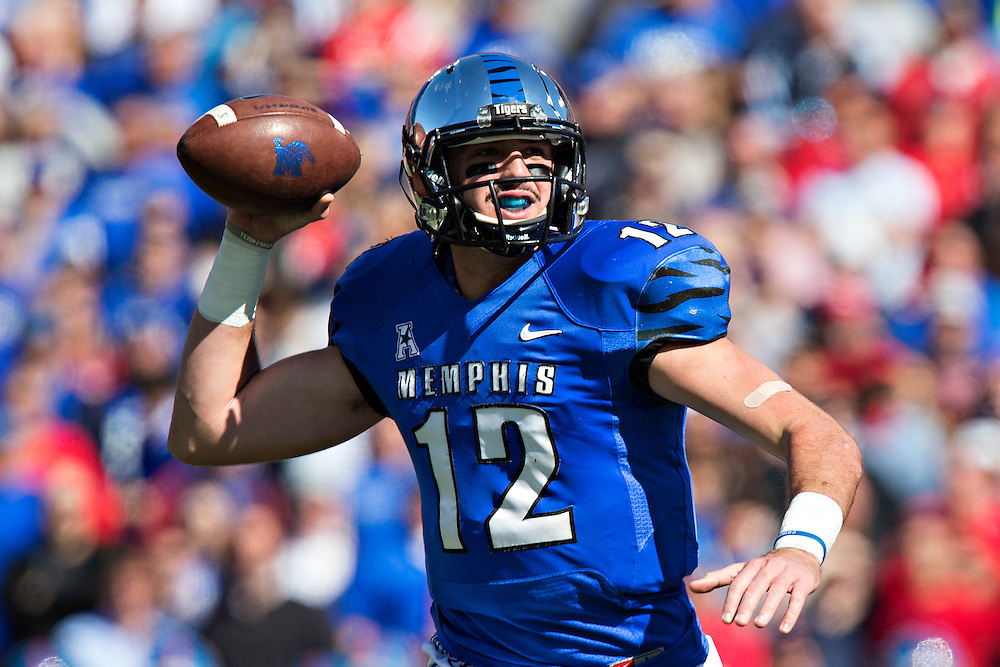 MEMPHIS, TN - OCTOBER 17:  Paxton Lynch #12 of the Memphis Tigers rolls out to pass during a game against the Ole Miss Rebels at Liberty Bowl Memorial Stadium on October 17, 2015 in Memphis, Tennessee.  The Tigers defeated the Rebels 37-24.  (Photo by Wesley Hitt/Getty Images) *** Local Caption *** Paxton Lynch