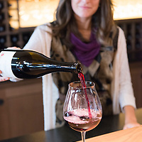 Employee Heather Daenitz (model released) pours a glass of Pinot Noir. Willamette Valley Vineyards is a well known producer of Pinot Noir and is located in Turner, just outside of Salem, Oregon.