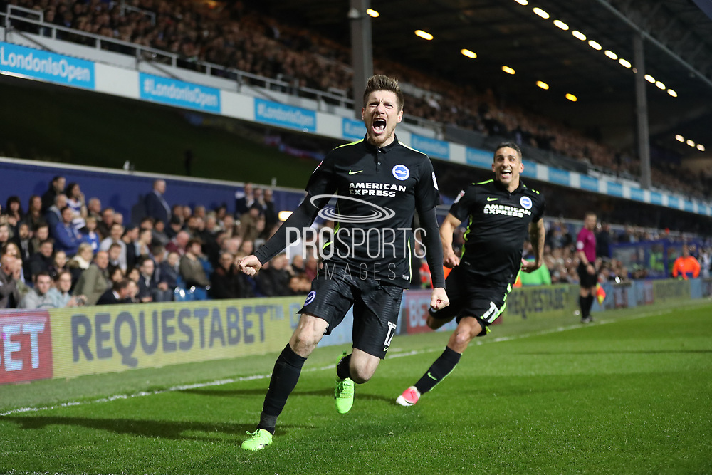 Brighton & Hove Albion defender Sebastien Pocognoli (12) scores a goal 2-0 and celebrates during the EFL Sky Bet Championship match between Queens Park Rangers and Brighton and Hove Albion at the Loftus Road Stadium, London, England on 7 April 2017.