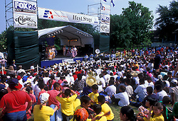 Stock photo of a crowd of people watching the presentation on stage at the International Festival in downtown Houston Texas
