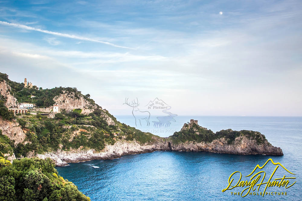 Moon over Amalfi Coast at Praiano Italy.  The jagged Amalfi Coast is full of tiny peninsulas crowned with defensive ramparts.  precipitous cliffs tower above where thousands of homes and hotels cling precariously hogging up massive views of the Mediterranean Sea.