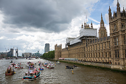 © Licensed to London News Pictures. 15/06/2016. London, UK. General view of the pro-Brexit campaign 'Fishermen for Leave', who are sailing a flotilla of over 30 vessels up the Thames. The flotilla, including UKIP leader Nigel Farage, caused traffic issues in central London, as vessels travelled up the Thames for high tide and to coincide with the last Prime Minister's Questions before the EU referendum takes place on 23 June. Photo credit : Tom Nicholson/LNP