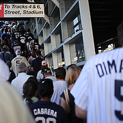 Fans arrive at the train station for the New York Yankees V New York Mets Subway Series Baseball game at Yankee Stadium, The Bronx, New York. 8th June 2012. Photo Tim Clayton